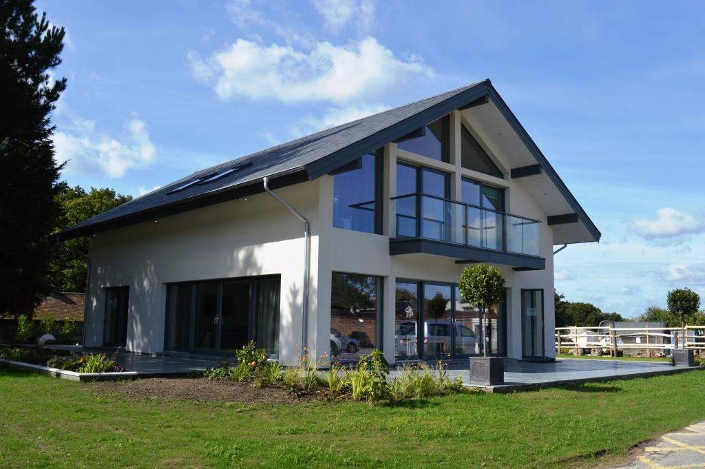 timber frame house designer scandia hus opens new show. Black Bedroom Furniture Sets. Home Design Ideas
